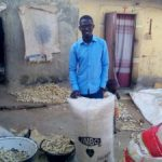 Fawamade Ebenezer, a GLP Fellow, poses with some proceeds of his harvest in Kaduna